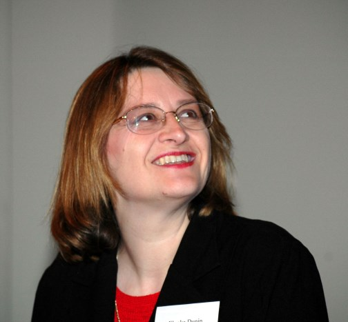 Elonka Dunin speaking at the 2005 NSA Cryptologic History Symposium, and smiling to see that her slides are working!